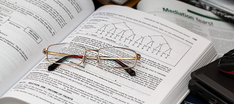 Image of glasses a book about finance.