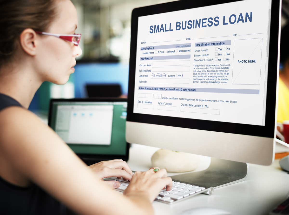 Woman looking at a business loan application on her computer.
